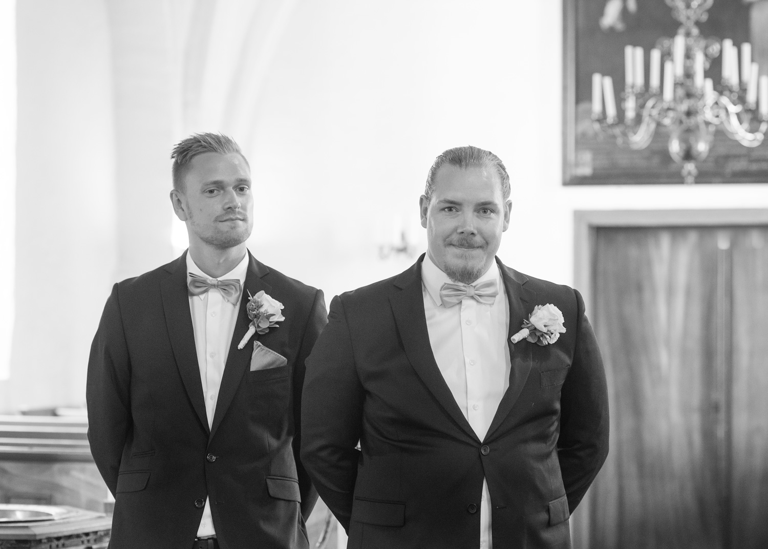 groom and best man waiting in church