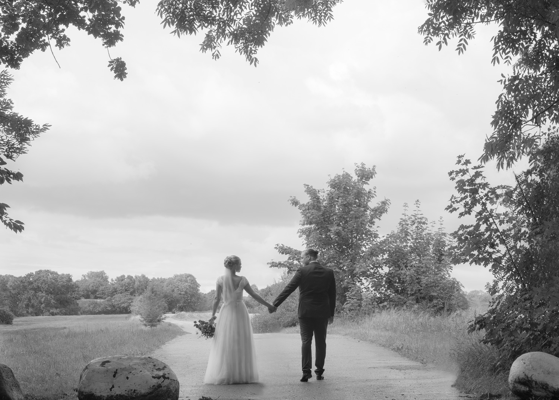 bride & groom on field