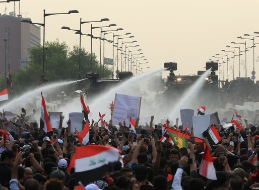 Protesters rise again in Iraq, street blockades, burning tires, clamoring for an end to sectarianism