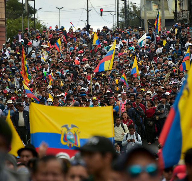 Ecuadorans protest with flags.jpg