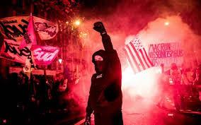 black dress protestor Paris.jpg