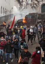 Quito Ecuador protest police vehicle bur