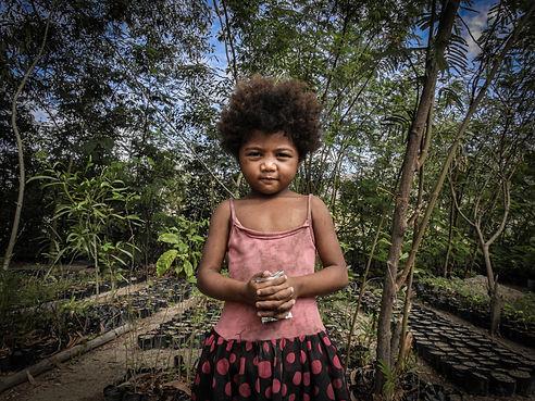 Yangil- Jamaica in front of her tree nursery.jpg