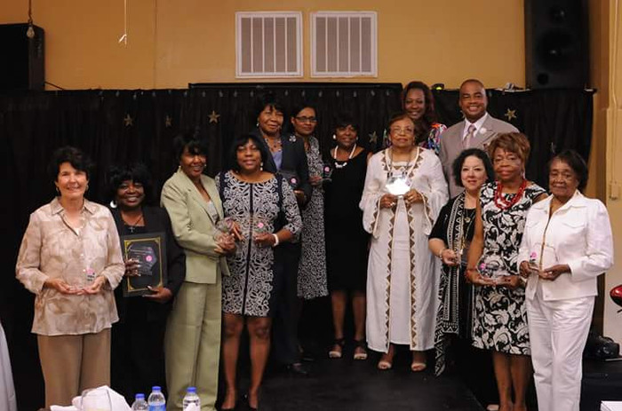 FLonzie and other honorees are presented awards by Mrs. Kathy Amos, Empowering Progressive Women's Association of Canton, MS.