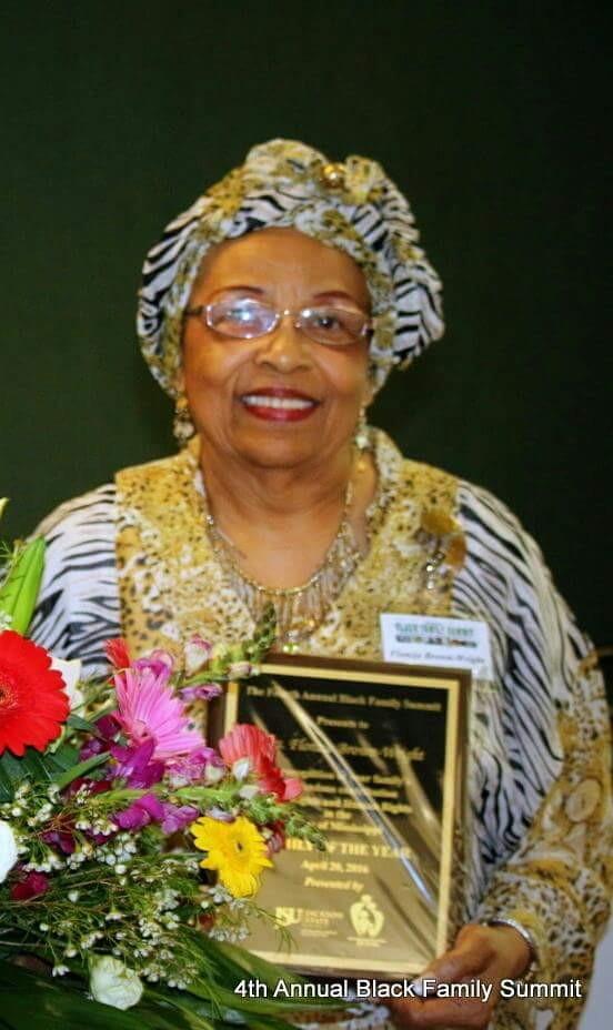 "Flonzie receives the ""Black Family Summit"" Award."