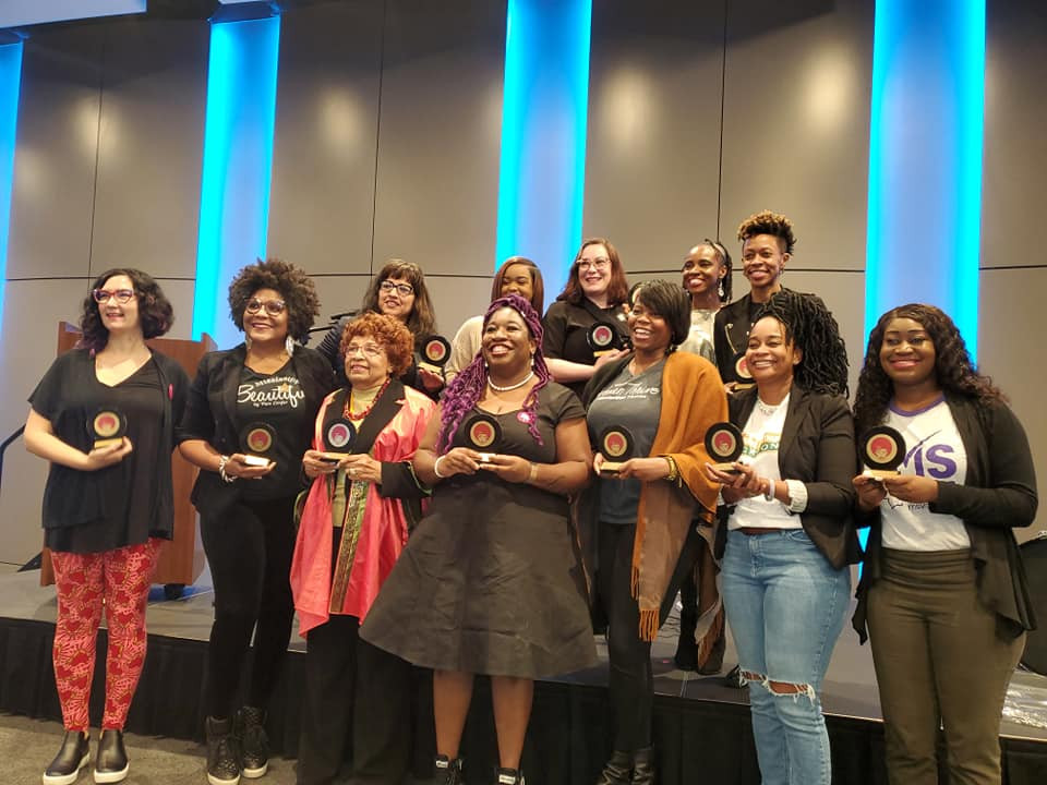 Flonzie and others guest speakers are presented awards by Talamieka Brice at the Womanist Rally on January 18, 2020 at the Miss. Civil Rights Museum.
