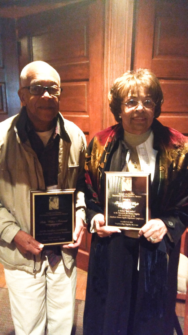 Flonze & Hollis Watkins pose with an award received at Tougaloo College by SHIROC.