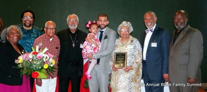 Flonzie recieves the Black Family Summit Award. Pictured are Cynthia Dorsey Smith, Frank Figgers, Hollis Watkins (unidentified), Mayor Chokwe Lumumba, Rev. Nettie Winters and fomer Mayor Robert Walker.