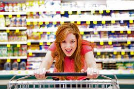 mom with shopping cart.  www.TeboPartnerships.com shows how to market to parents, especially moms.