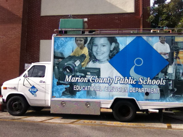 logo for Marion County Public Schools on a school-owned with fleet vehicle.