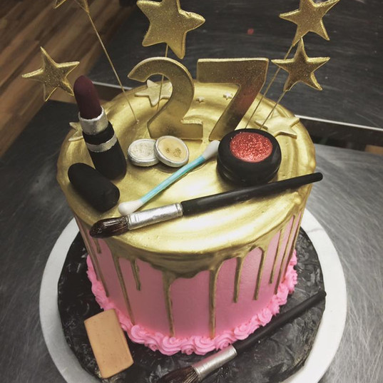 gold drip cake with makeup.jpg