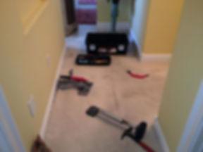 Restretching carpet.jpg