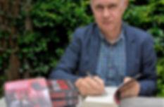 Photograph of Jake Buchan book signing