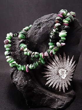 ruby zoisite crystal chip bracelet displayed on chrysanthemum stone, bracelet with green and pink stone