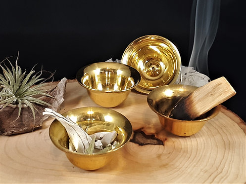 group of golden colored Tibetan brass offering bowls