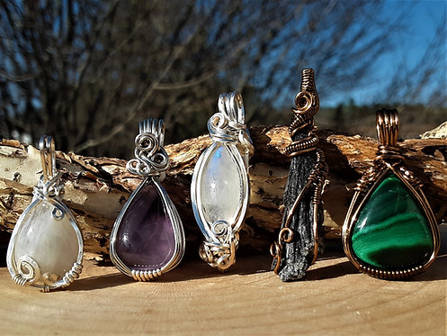 row of five mini wire wrapped gemstone pendants