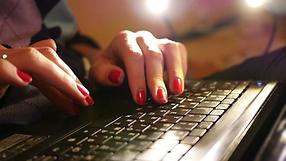 female-fingers-typing-laptop-computer-ke
