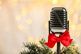 Microphone with red bow and fir branches