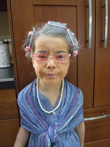Doodlebug face painting old lady.jpg