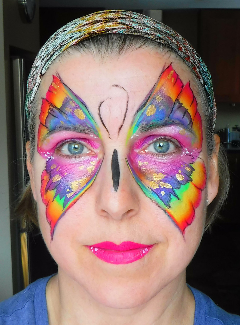Doodlebug face painting butterfly.jpg
