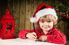 Blond boy writes a letter to Santa.jpg