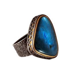 A ring with a wide textured silver band, a rounded triangle labradorite stone, a gold bezel and an outer pierced silver bezel