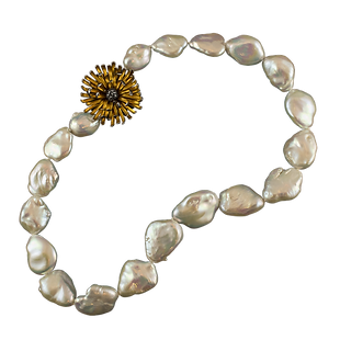 A strand of baroque pearls with a small gold and oxidized silver mum clasp