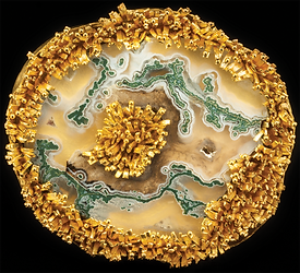 A brooch/pendant made with 22 karat gold tufts, granulation, and a limb cast moss agate