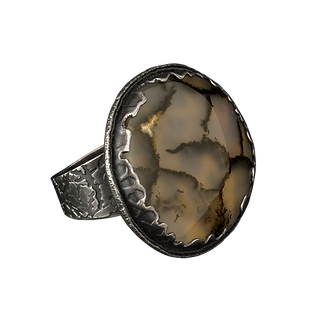 A ring with a textured silver band, a scalloped textured silver bezel, and a large montana moss agate cabochon.