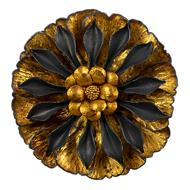 A flower shaped brooch with broad gold overlay petals, oxidized silver petals, and 22 karat gold granulation