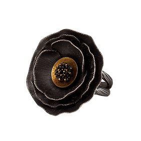 An oxidized sterling silver ring shaped like a poppy flower, with a gold dish in the center with a silver tassel and gold granules, and a twig-textured double band
