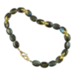 A strand of labradorite beads with 22 karat gold spacers and a 22 karat gold clasp with twig textures