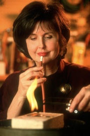 Judith Kinghorn using a mouth blow torch