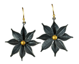 Dangling earrings made with oxidized sterling silver textured flowers