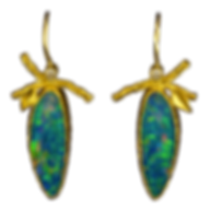 Dangling earrings made with texturesd 22 karat gold bezels, twigs, leaves, diamonds, and boulder opals