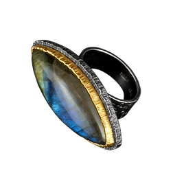 A ring with a labradorite marquise cabochon, a double silver and gold bezel, and a textured silver bezel