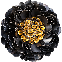 A brooch/pendant with articulated sterling silver petals and 24 karat gold overlay discs