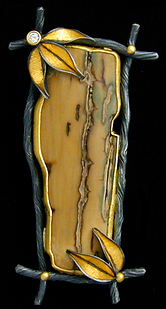 A brooch/pendant made with oxidized sterling silver twigs, 22 karat gold balls, gold leaves, a diamond, and fossil ivory