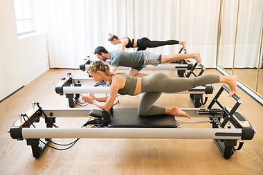 Group of friends doing pilates kneeling