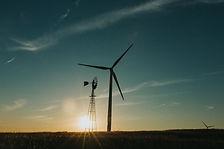 traditional wind mill alongside a wind turbine