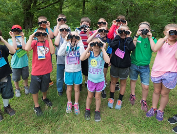 elementary students looking through binoculars