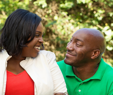 SmilingBlackCoupleAtEachOther.png