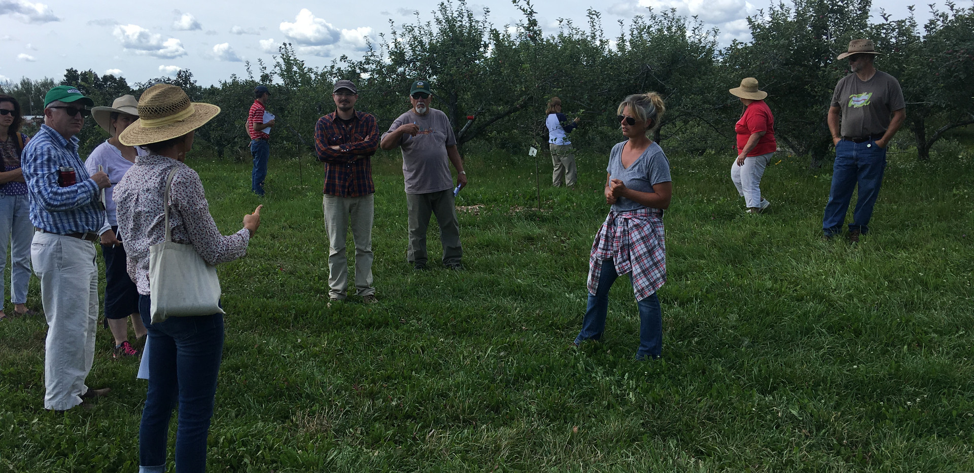 Lisa with other orchardists at her farm in Antigo, WI in August, 2019