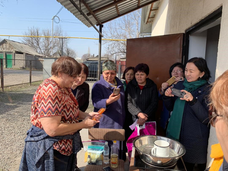 Farmer to Farmer Volunteer Kate Penhallegon demonstrates how to diversify products in home based businesses in Kyrgyzstan.