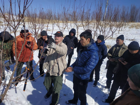 Farmer to Farmer Volunteer Ross Penhallegon discusses Fruit Orchard Care with local farmers in Kyrgyzstan.