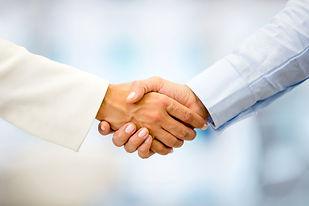 Successful business people handshaking c