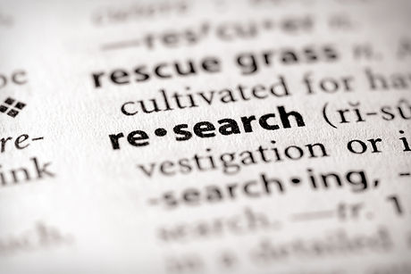 "Selective focus on the word ""research""."