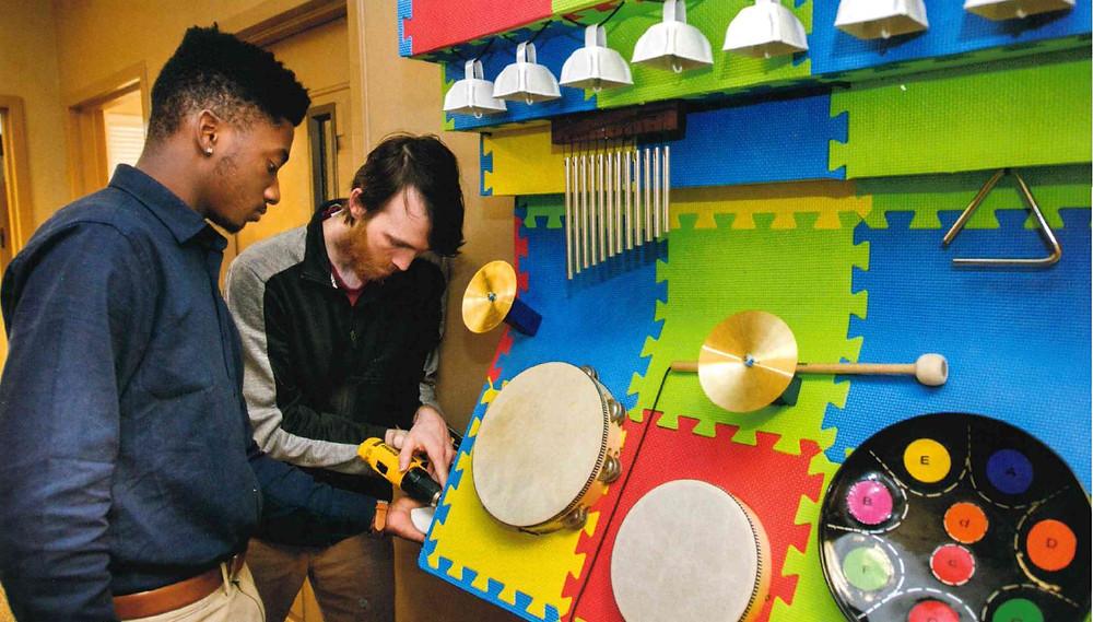 People building / repairing drum set