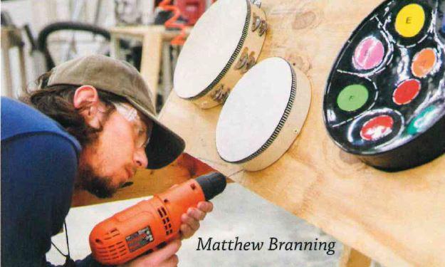 Matthew Branning - man building drum set
