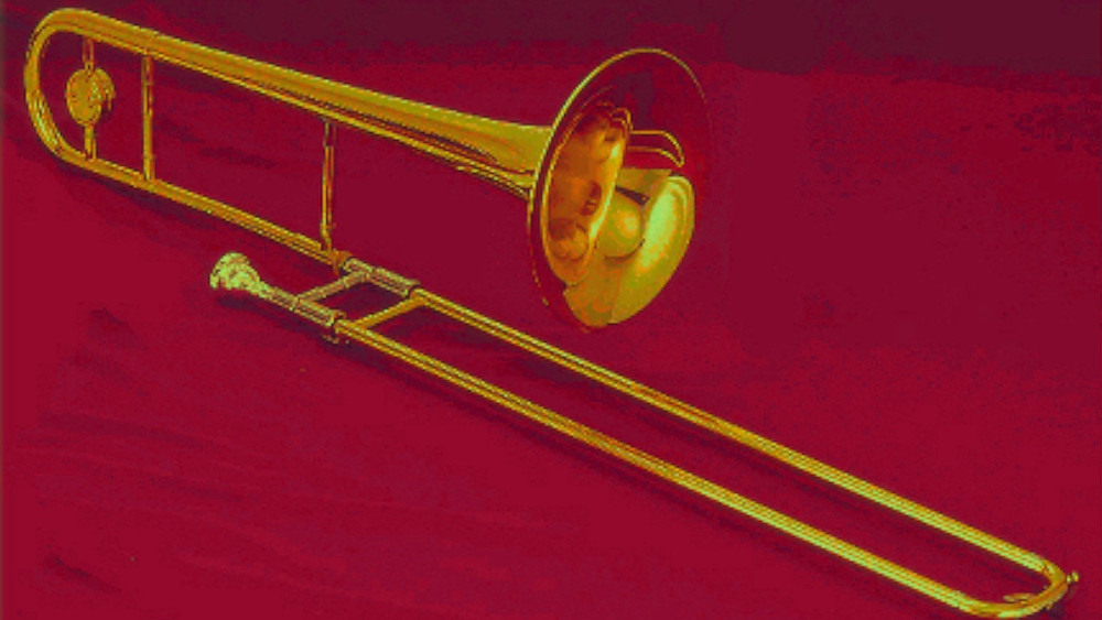 golden trombone on red velvet